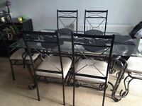 Wrought iron glass table and six chairs
