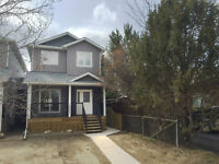Semi-Detached Two Story home right by the river!
