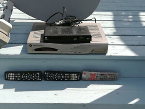 Shaw satilite with two receivers and three remotes