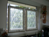 Pair of antique windows with etched design