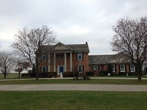 Beautiful Country Property with House, Barns and Acreage