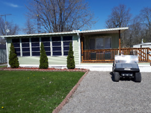 WELL MAINTAINED TRAILER, FAMILY FRIENDLY PARK LOT 238