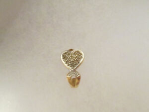 One 10kt Gold earring with tiny diamonds