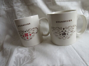 two 18.5 oz starbucks coffee mugs-price is for th 2 / firm price