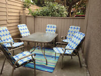 Patio set: table, 6 chairs and floor mat