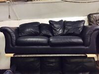 As new large navy 2 seater leather sofa