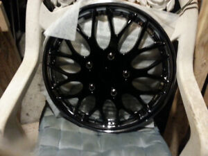 Four 16 inch plastic wheel covers...