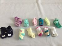 11 pairs of socks and one booties