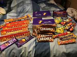 Assorted lot of chocolate and candy.