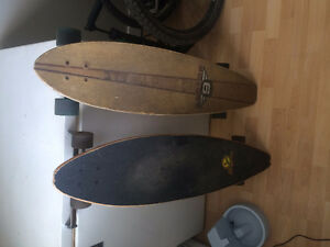 2 Longboards, layback and sector 9.