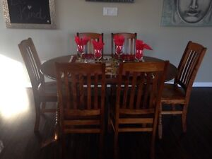 8 beautiful solid birch dining chairs and maple table in ponoka