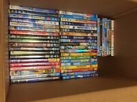 54 Assorted DVDs in a box.