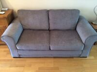 Large 2 seater grey sofa bed. In excellent condition, used only few times