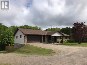 large home near Bancroft with dual level garages