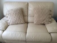 Two seater lazy boy cream leather sofa.