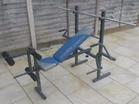 York (I think)Exercise Bench with Leg Curls & two weight stands