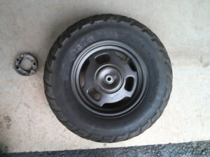 Honda Ruckus wheel with stock tire