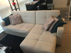 Two-piece cream coloured sectional sofa
