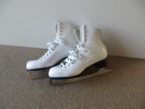 Lady's white skates - size 6 or 7