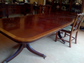 Large antique large dinning room table. Really beautiful quality.