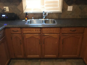 Entire used kitchen - cabinets, counter, sink.