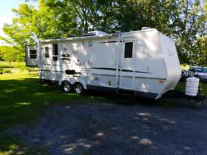 Aruba 25RS camper trailer with bunks and two slides
