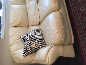 Leather sofa and chair with foot rest.