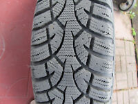 Four 185/65R/15 Winter tires on steel rims (Like new)