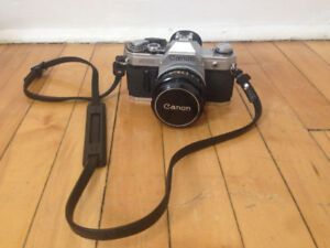 Vintage Cannon SLR Camera with Leather Case