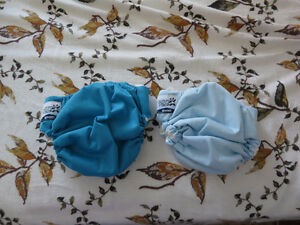 NEVER USED--cloth diapers (softbums echo omni, etc.)