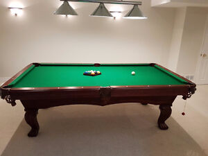 Professional 8' billiard table with fancy wall rack and lighting