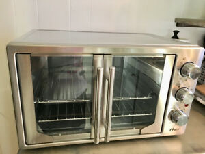 Brand New Oster Toaster/Convection oven with French Doors