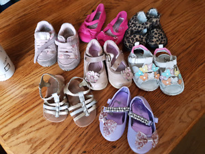 7 pairs of girls shoes.
