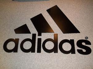 Adidas logo wall sign