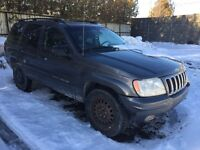 2002 jeep grand cherokee limited 4.7 ho pieces ou route