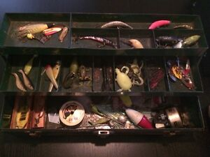Vintage fishing lures, reels and tackle box