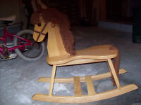 Beautiful solid wood rocking horse.