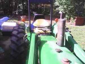 John Deere model 1120 tractor and Hardy 8 Foot backhoe