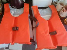 2 x orange small/medium life jackets