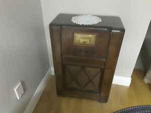 Sparton antique vintage floor radio and record player.