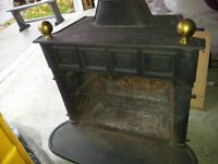 cast iron wood stove and stove pipe