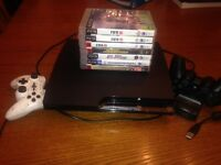 PS3 slim 300gb bundle with wireless remote and 7 games