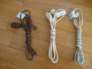 THREE 6-FOOT INDOOR EXTENSION CORDS..[1 BROWN..2 WHITE]