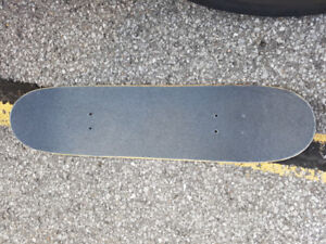used skateboard deck with brand new grip tape and set of wheels!