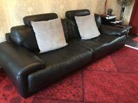 Black expensive hide sofa, chair and footstool