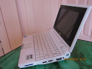 Asus EEE PC 2G Surf Netbook running Russian Windows XP 7 inch
