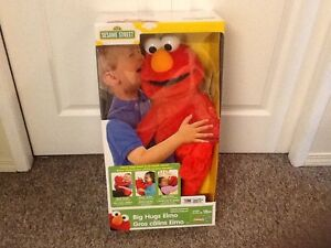 LIKE NEW BIG HUGS ELMO
