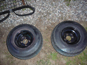Golf Cart wheels and tires $25 each.