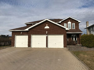 2500 sq/ft 2 Storey Brick House with Attached Garage.