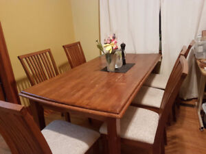 wooden table and 6 chairs in off white fabric